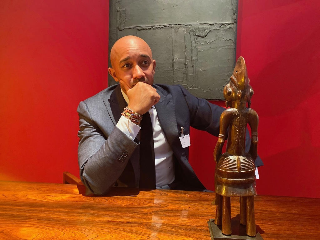 Art dealer Didier Claes with a Senufo sculpture at his Brafa stand.